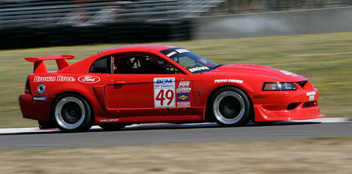 side view of Tim Brown's red Ford Mustang race car