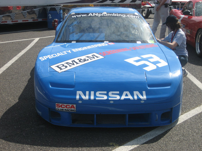 closeup of blue Nissan 240SX race car