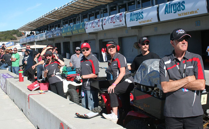 Pit crew looking over the pit wall at laguna runoffs