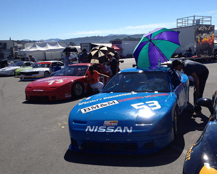 umbrellas out protecting from the hot sun during qualifying nissan 240sx blue #53 and red #73