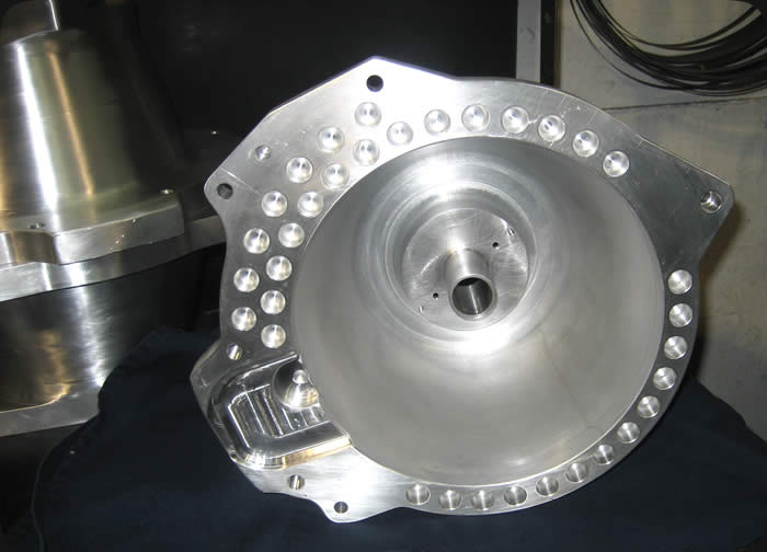 Specialty Engineering machining billet bell housing for race transmission